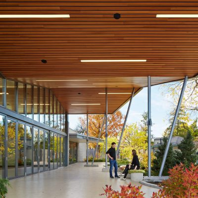 9Wood 2300 Continuous Linear exterior wood ceiling installation at Brookfield Zoo, Chicago, Illinois. Booth Hansen.
