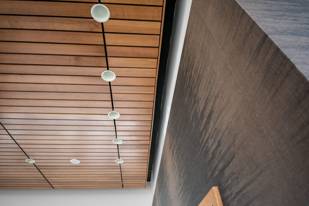 Lighting integration is crucial for linear wood ceilings. While acoustic subcontractors are skilled in installing to specification, nearly all lighting and MEP can integrate with a wood ceiling or a linear wood ceiling for that matter.