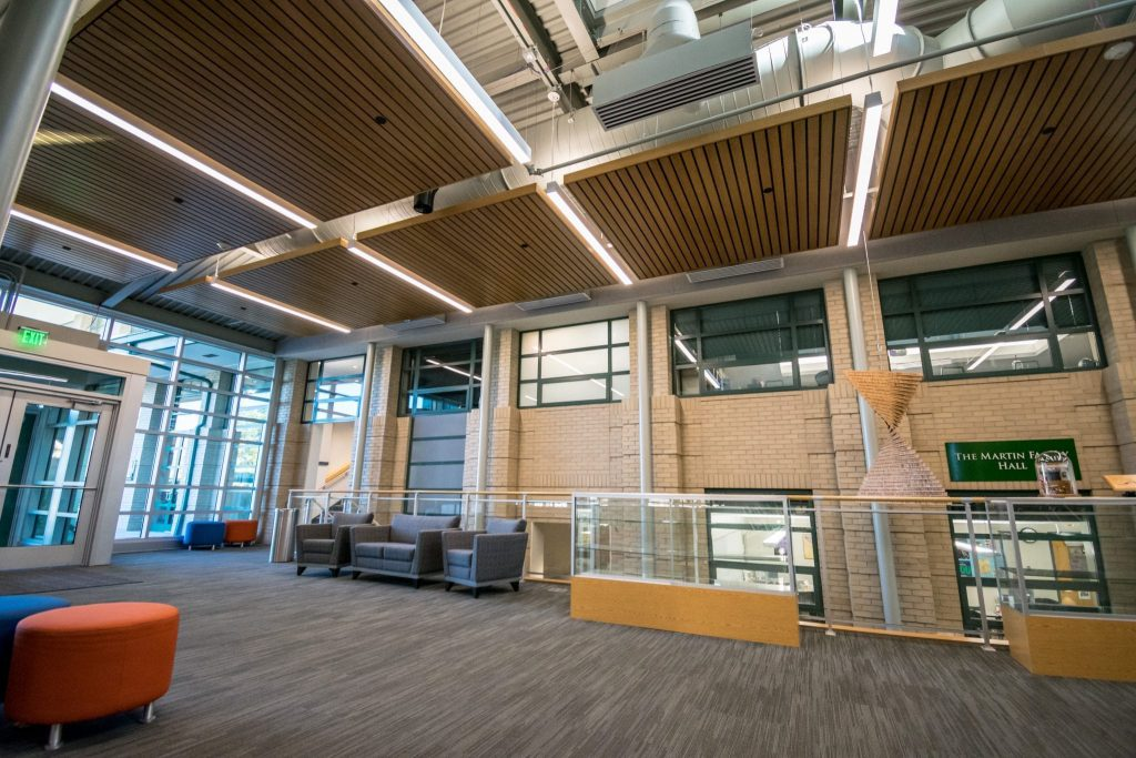 continuous linear wood ceiling with a stained white maple veneer