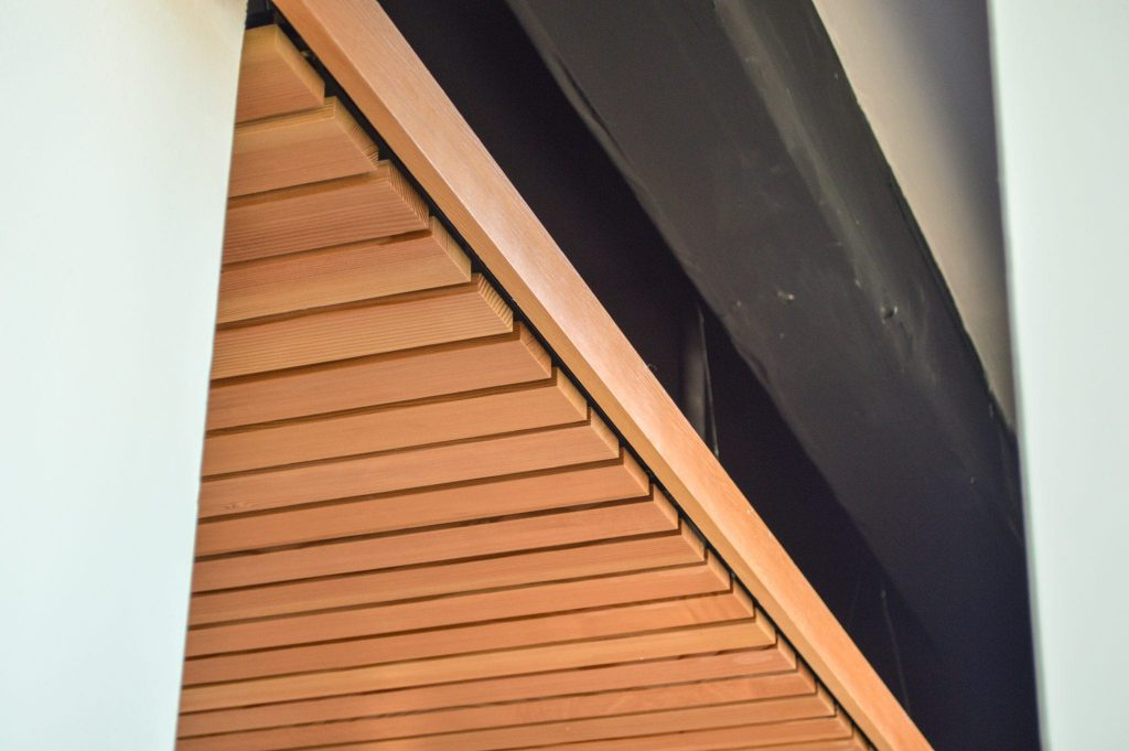 Panelized linear wood ceilings can be identifed by the gap between the individual members.