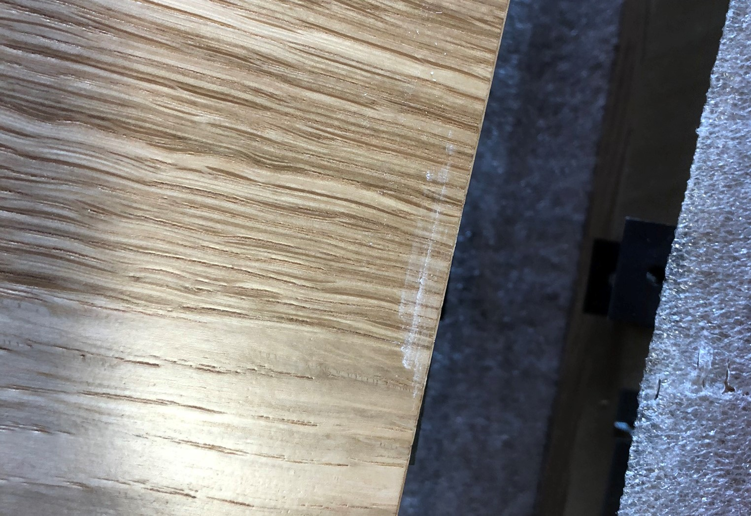 Scratches can appear on the face of tiles or other wood ceiling products during handling at the jobsite.