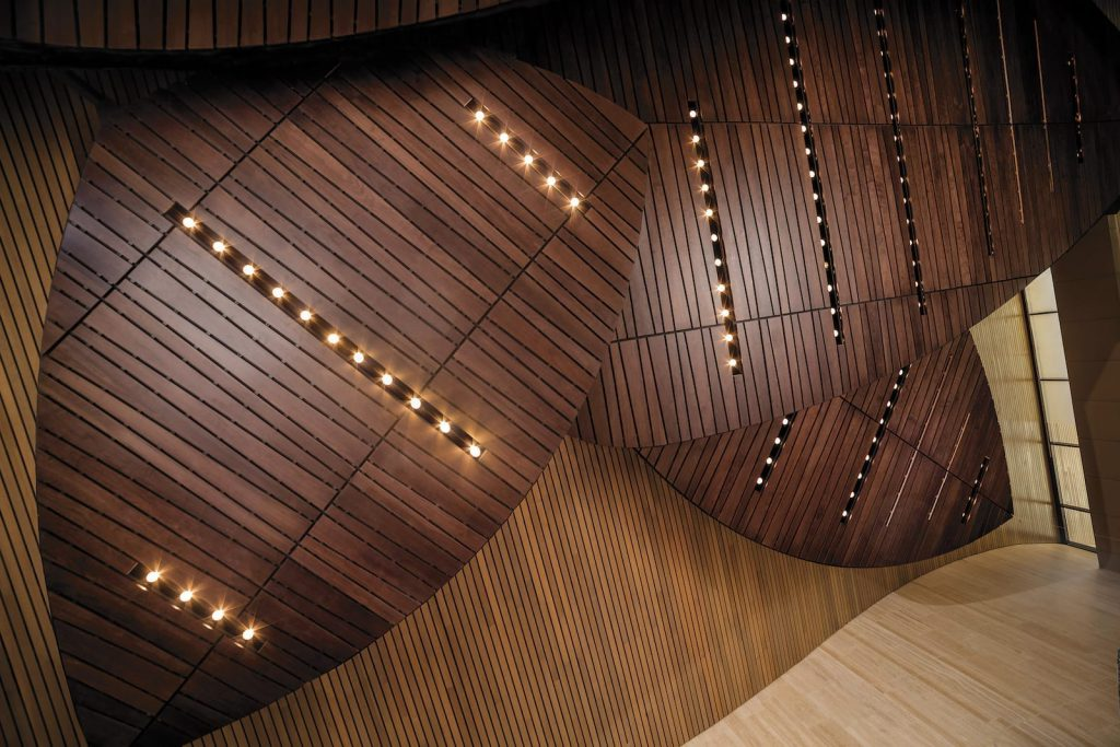 economical wood ceiling option with a continuous linear with a stained veneer