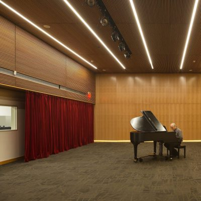 9Wood's 1100 Cross Piece Grill in Solid Western Hemlock with Stain at Alaska State Library, Archives and Museum, Juneau, Alaska. Hacker Architects. Photo: Lara Swimmer. The building features standard wood grille ceilings on single, horizontal elevations. Photo: Lara Swimmer.