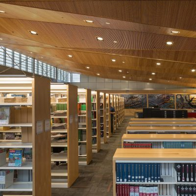 9Wood's 1100 Cross Piece Grill in Solid Western Hemlock with Stain at Alaska State Library, Archives and Museum, Juneau, Alaska. Hacker Architects. Photo: Lara Swimmer. In the library, the wood grille ceiling's compound, pie- shaped sections flow from a height of 22' down to 16'. Photo: Lara Swimmer.