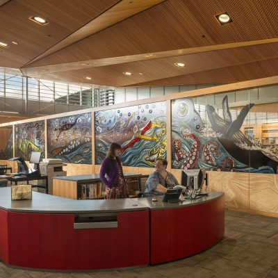 9Wood's 1100 Cross Piece Grill in Solid Western Hemlock with Stain at Alaska State Library, Archives and Museum, Juneau, Alaska. Hacker Architects. Photo: Lara Swimmer. The Alaska State Library, Archives and Museum features a 21,250 sq.ft. wood grille ceiling over its library and other spaces. Photo: Lara Swimmer.