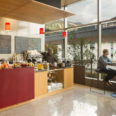 9Wood's 1100 Cross Piece Grill in Solid Western Hemlock with Stain at Alaska State Library, Archives and Museum, Juneau, Alaska. Hacker Architects. Photo: Lara Swimmer. The coffee and snack bar features a wood grille ceiling suspension. Photo: Lara Swimmer.