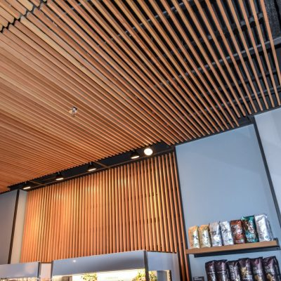 9Wood 1100 Cross Piece Grille at Starbucks - 35th & State St., Chicago, Illinois. HOK.