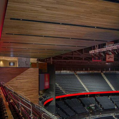9Wood's 2300 Continuous Linear in White Oak Veneer with stain at State Farm Arena in Atlanta, Georgia. HOK. The arena's wood ceilings and walls are expansive. The tiered look is a unique landscape traversing the building and clothing it with warmth. Photo: Creative Sources Photography.