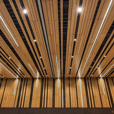 9Wood's 2100 Panelized Linear at the Hyatt Regency Seattle in Seattle, Washington. LMN Architects. 9Wood made optimal use of material, using off-cuts from one end of the system efficiently at the other so as to minimize waste and maximize yield.