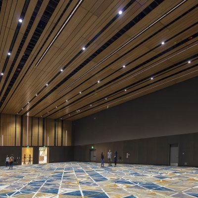 """9Wood's 2100 Panelized Linear at the Hyatt Regency Seattle in Seattle, Washington. LMN Architects. The panels — 493 ceiling panels and 339 wall panels — are made with 3/4-in. plain sliced white oak veneered wood. The wood members have various widths, and the panels themselves vary in width and length. The effect is to create a unique pattern and feel, what the architect calls a """"woven wood basket."""""""
