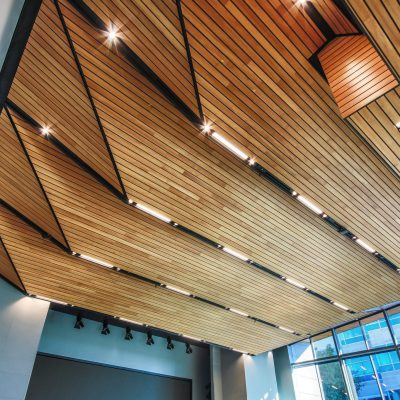 9Wood's 2300 Continuous Linear in Solid Western Hemlock with Stain at Charles Schwab Campus in Austin, Texas. Page. DPR Construction and 9Wood designed the ceilings off of a rough concept submitted by the architect. The photo shows perfectly consistent reveals. The wood was all cut in the field.