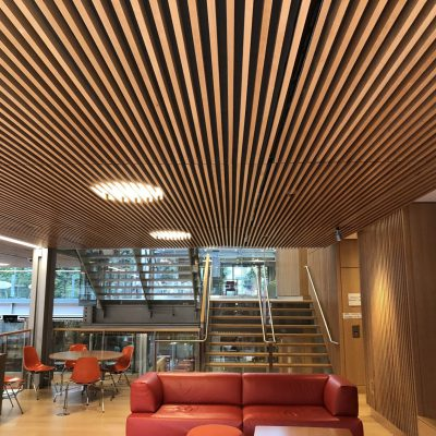 """9Wood's 1100 Cross Piece Grille in FSC certified Solid European Beech with Clear Finish at The Smith Campus Center, Harvard University, Cambridge, Massachusetts. Hopkins Architects and Bruner/Cott Architects. The FSC certified beech used for the wood grille ceiling was sourced in Germany from the largest beech supplier in the world. Natural outdoor light activates """"the warm hue and deep texture of the European beech walls and ceilings,"""" the architect says."""