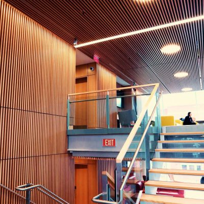 9Wood's 1100 Cross Piece Grille in FSC certified Solid European Beech with Clear Finish at The Smith Campus Center, Harvard University, Cambridge, Massachusetts. Hopkins Architects and Bruner/Cott Architects. The 18,075 sq. ft. of wood grille ceilings were suspended on multiple levels and needed to match precisely the grille wall systems installed by a separate millwork contractor.