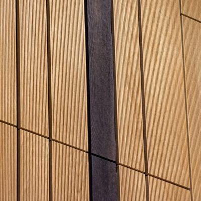 9Wood's 2100 Panelized Linear at the Hyatt Regency Seattle in Seattle, Washington. LMN Architects. The faces of the wood members are each milled with 1/16 in. kerfs. The kerfs are 8 mm o.c. and run the full length of all members. Perforations on the backs of the planks have matching edge-banding, which are applied to all edges.