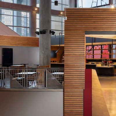 """9Wood's 2300 Continuous Linear in White Oak Veneer with stain at State Farm Arena in Atlanta, Georgia. HOK. The """"club"""" area showcases a mixed use of materials. The design approach was to create """"a new, welcoming living room for Atlanta,"""" says Architect Emily Louchart of HOK.  Photo: Creative Sources Photography."""