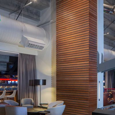 9Wood's 2300 Continuous Linear in White Oak Veneer with stain at State Farm Arena in Atlanta, Georgia. HOK. The subcontractor, Anning-Johnson, mitered perfect corners for a bump-out wall. The architect wanted to apply resources to where it mattered and appealed to fans.