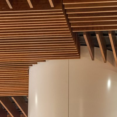 9Wood's 1100 Cross Piece Grille at the Hyatt Regency Seattle in Seattle, Washington. LMN Architects. The restaurant ceiling was laid out as dozens of separate floating clouds.