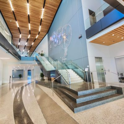 9Wood's 2100 Panelized Linear in Solid Western Hemlock with Stain at Charles Schwab Campus in Austin, Texas. Page. The panelized linear ceilings run on the lower lobby level and at the top of the staircase.