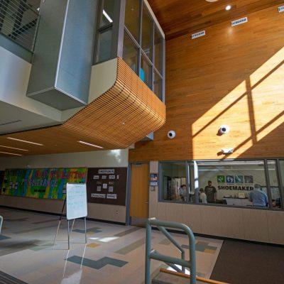 9Wood 2700 Kerf Reveal Linear and 1100 Cross Piece Grille at Joe Shoemaker Elementary School, Denver, Colorado. AndersonMasonDale Architects.