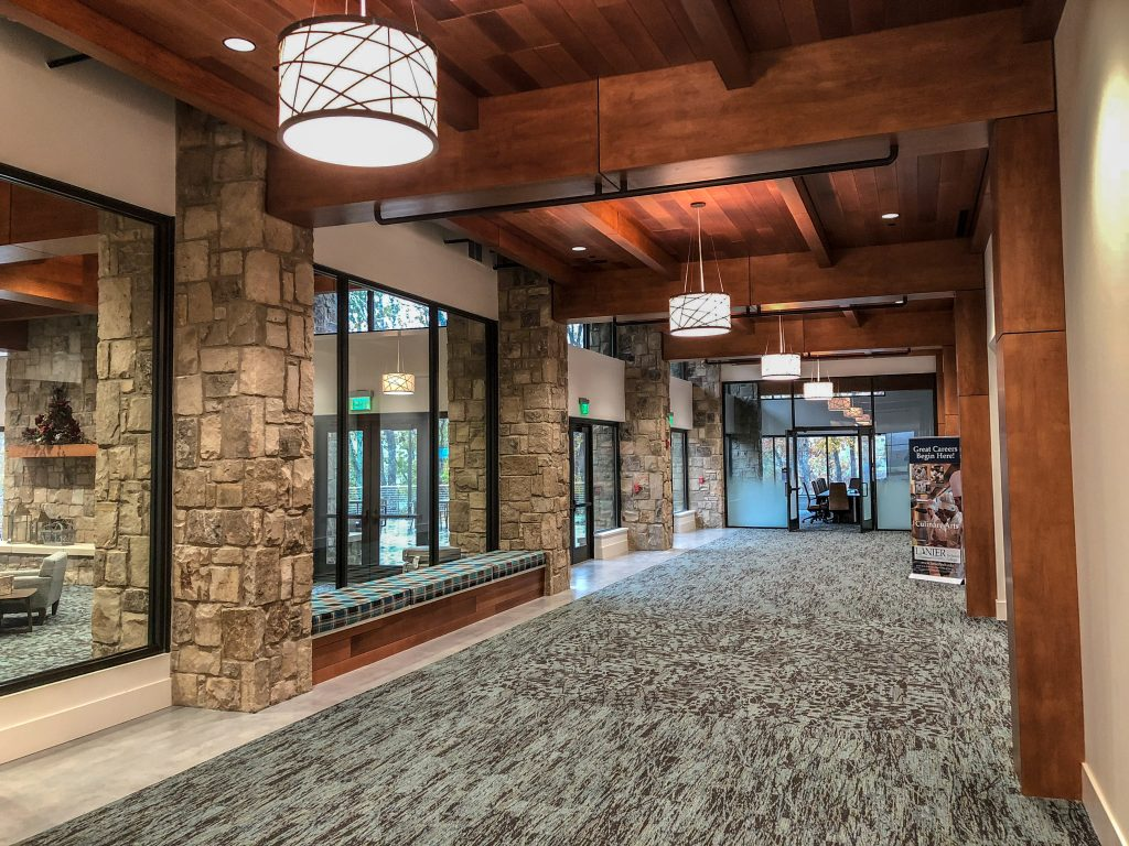 most beam ceilings that we appreciate have wood as a main feature. Often times wood grilles or linear wood will be used around a beam matched to the same finish color.