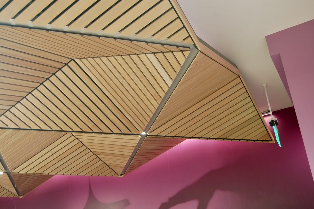 Specialty materials, such as linear wood ceilings, can be cut into custom shapes