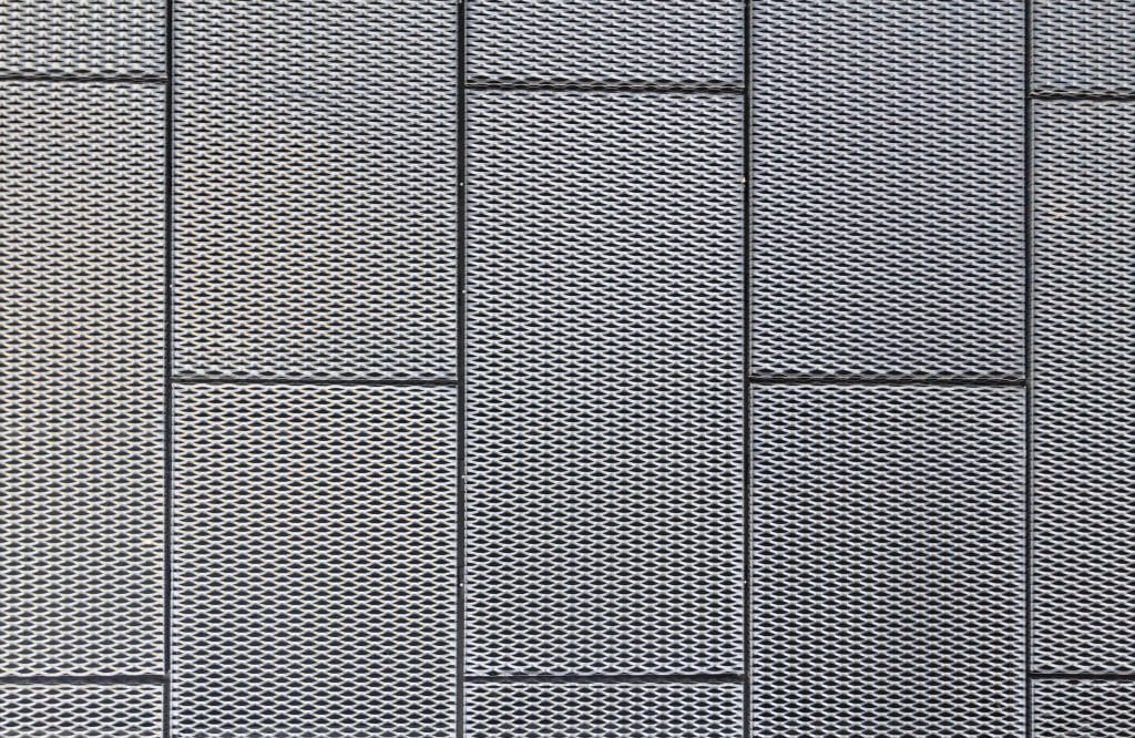 Perforated metal ceilings provide acoustical value, depending on percentage opening